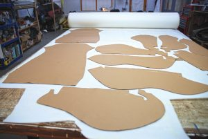 All work is carried out in specific areas of the premises. Here, trim pieces are being cut out from templates.