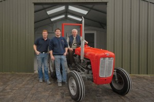 Father and son team: (l-r) General Manager Darren, Production Manager Thomas and founder and MD Sean on his 4-cylinder diesel MF35.