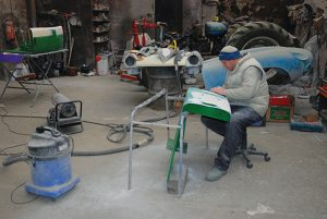 Jack is seen here working on the JD wings, with the bonnet for the Jag and Spitfire in the background; note the Roadless.